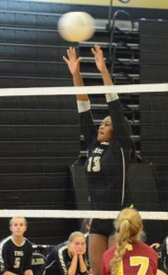 Trumbull High's Imani Bell goes up for a block. — Andy Hutchison photo