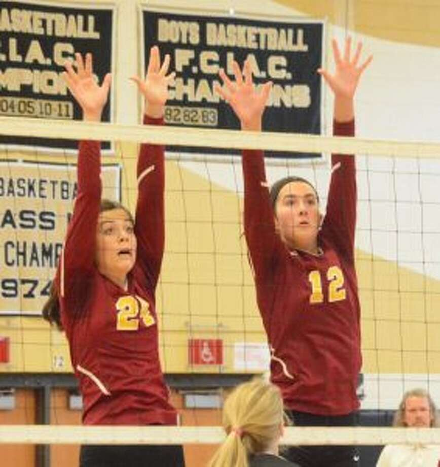St. Joseph's Maddie Johnson and Christina Crocco have helped the Cadets win 11 matches.