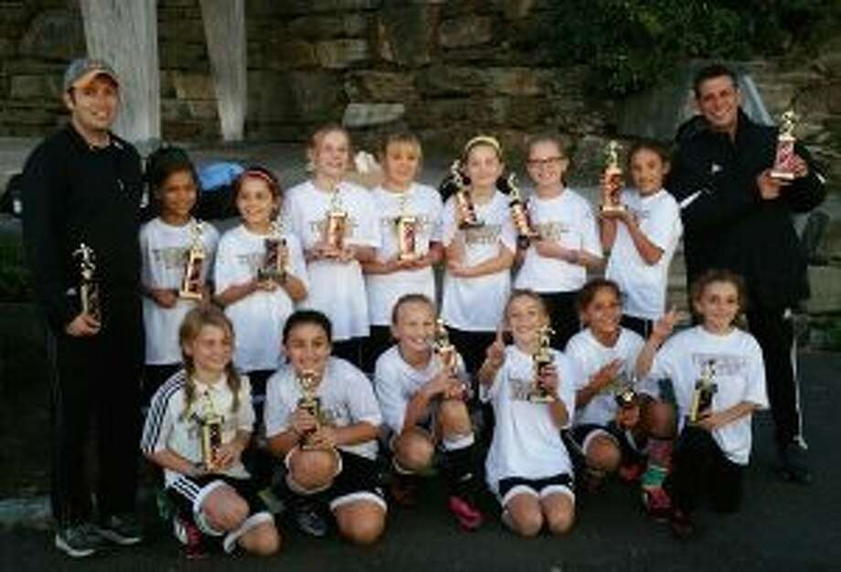 The U-11 Trumbull Tornadoes celebrate their strong finish in the Rocky Hill Tournament. The team consists of coach Cipriano Pinto, Sophia Bennett, Briana Buda, Lucy Carlson, Adele Datz, Brooke Hebeler, Ellie Hebeler, Leela Kocinsky, Abby Lee, Mia Mallone, Katie Marchand, Anabela Martins, Jane Parente, Hope Platt and Avianna Rivera.