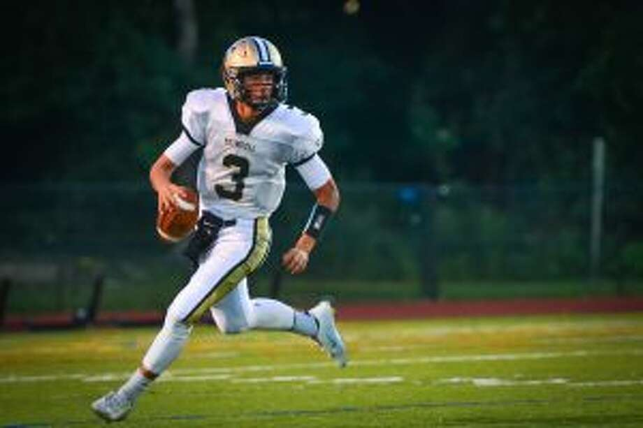 Trumbull's Johnny McEltoy threw for two touchdowns and ran 64 yards for another in the Eagles' win over Trinity Catholic.