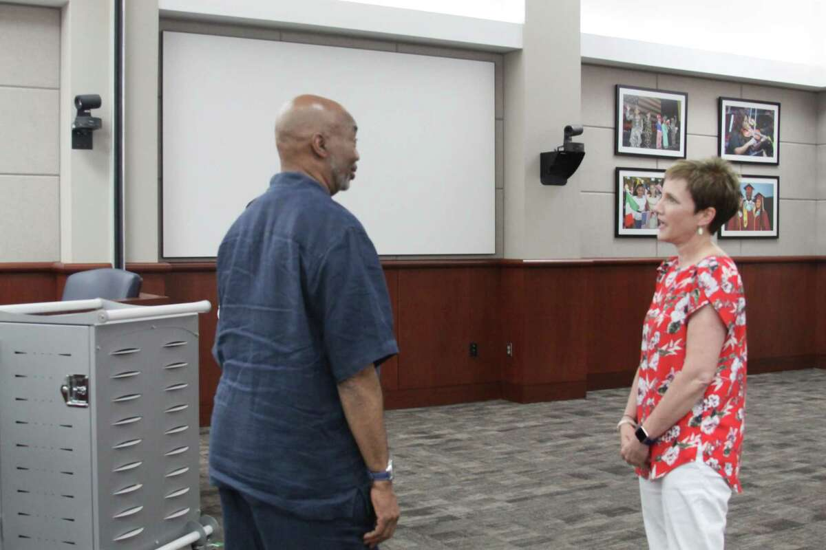 Cypress-Fairbanks ISD board president John Ogletree speaks with Julie Hinaman after she is selected to be a trustee for position 2 on the board during a special meeting on Monday, June 3, 2019.