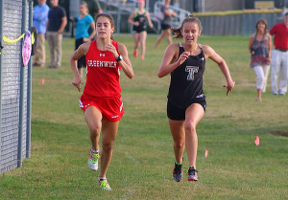 Trumbull's Kate Romanchick and Greenwich's Emily Philippides race to the finish line.