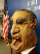 """Wood carving of """"The Transient Spirit of 1935."""""""