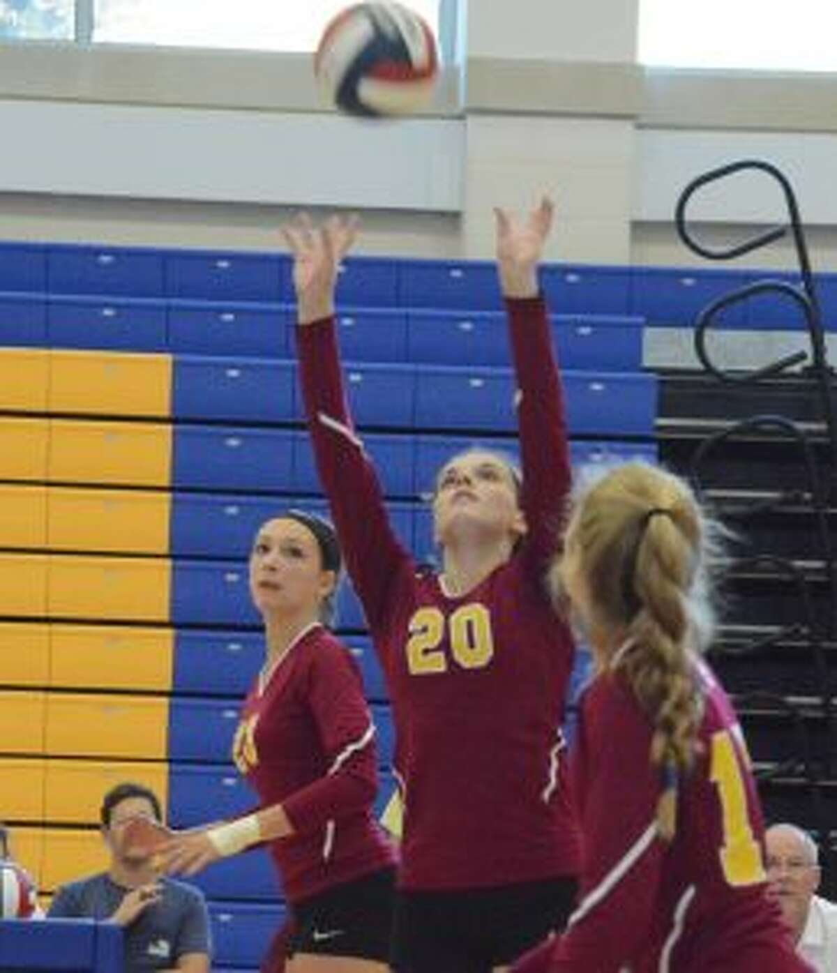 Megan Robinson sets the ball for St. Joseph in its 3-2 win over Newtown. - Andy Hutchison photo