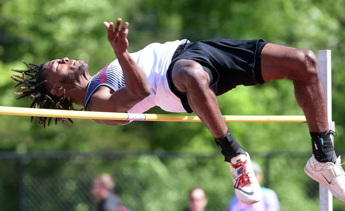 Justin Forde of McMahon clears 6-6 in the high jump during the CIAC State Open Outdoor Track & Field Championshipon Monday in New Britain.