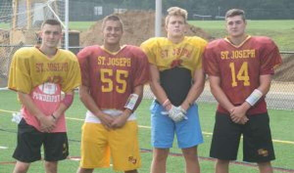 St. Joseph's Nick Osborne, Alec Pelletier, Brian Harner and Cory Babineau are team captains. - Bill Bloxsom photo