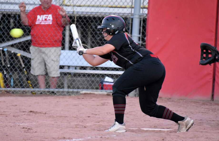 Cheshire's Lexi Hemstock bunts in during the Class LL semifinal game against NFA on Sunday. Photo: Pete Paguaga / Hearst Connecticut Media / Connecticut Post