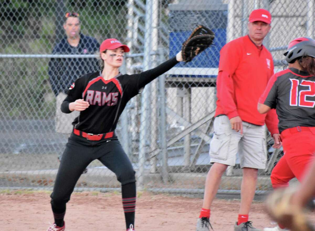 Cheshire's Emma Watkinson stretches for a ball against NFA in the Class LL semifinals on Monday.