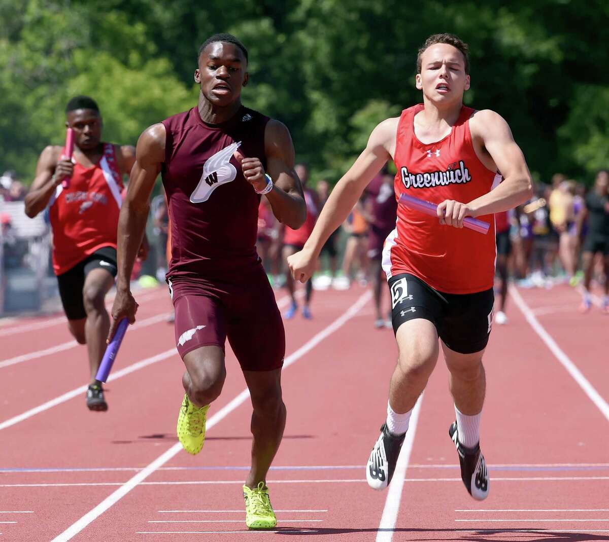 Greenwich's Zane Robinson-Nye (right) runs the last leg of the 4x100-meter relay to a win in the CIAC State Open Outdoor Track & Field Championship on Monday in New Britain.
