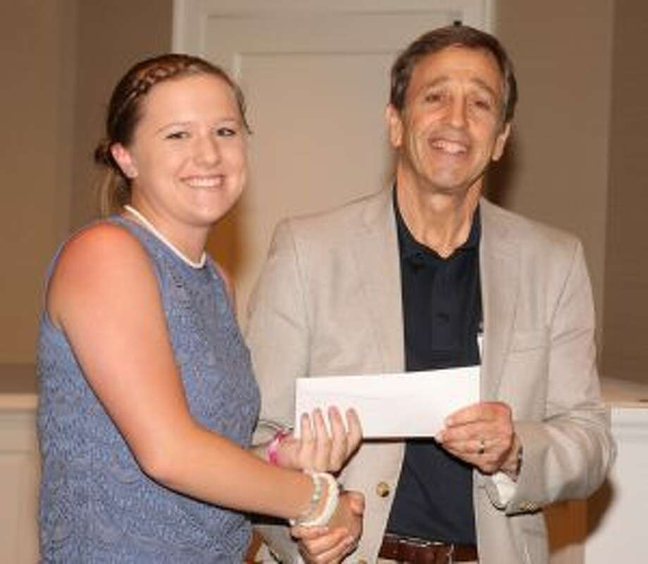 Martin D. Schwartz, President and CEO of The Kennedy Center, presents Grace McLean, a student at Trumbull High School, with a scholarship at Shorehaven Golf Club in Norwalk.
