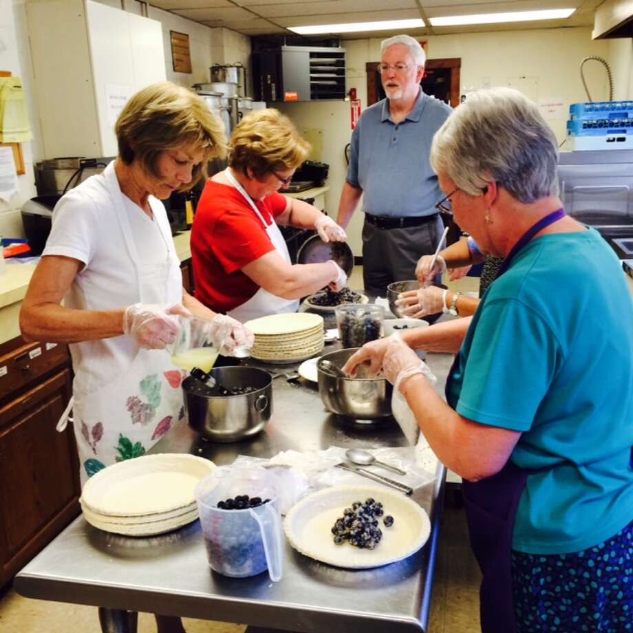 Inside Trumbull's Long Hill United Methodist Church, blueberry pies are being made for the annual Blueberry Festival. (Blueberry Festival from a previous year).