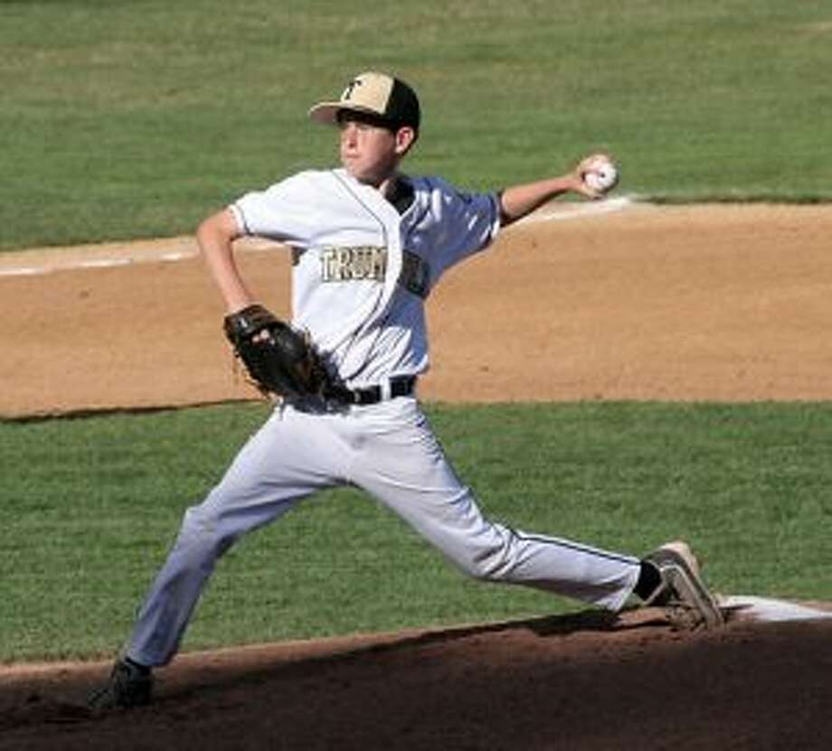 Ryan Carroll delivers a pitch in Trumbull U13's 7-1 win over Simsbury. — Bill Bloxsom photos