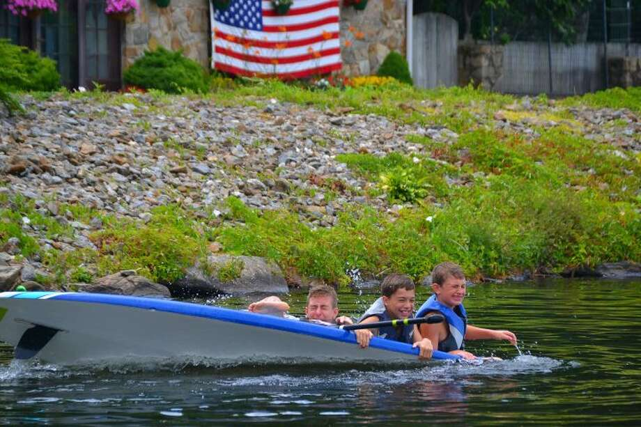 Trumbull residents Jason, Jack, and Billy go overboard into Pinewood Lake over the Fourth of July weekend. — Lisa Romanchick photo