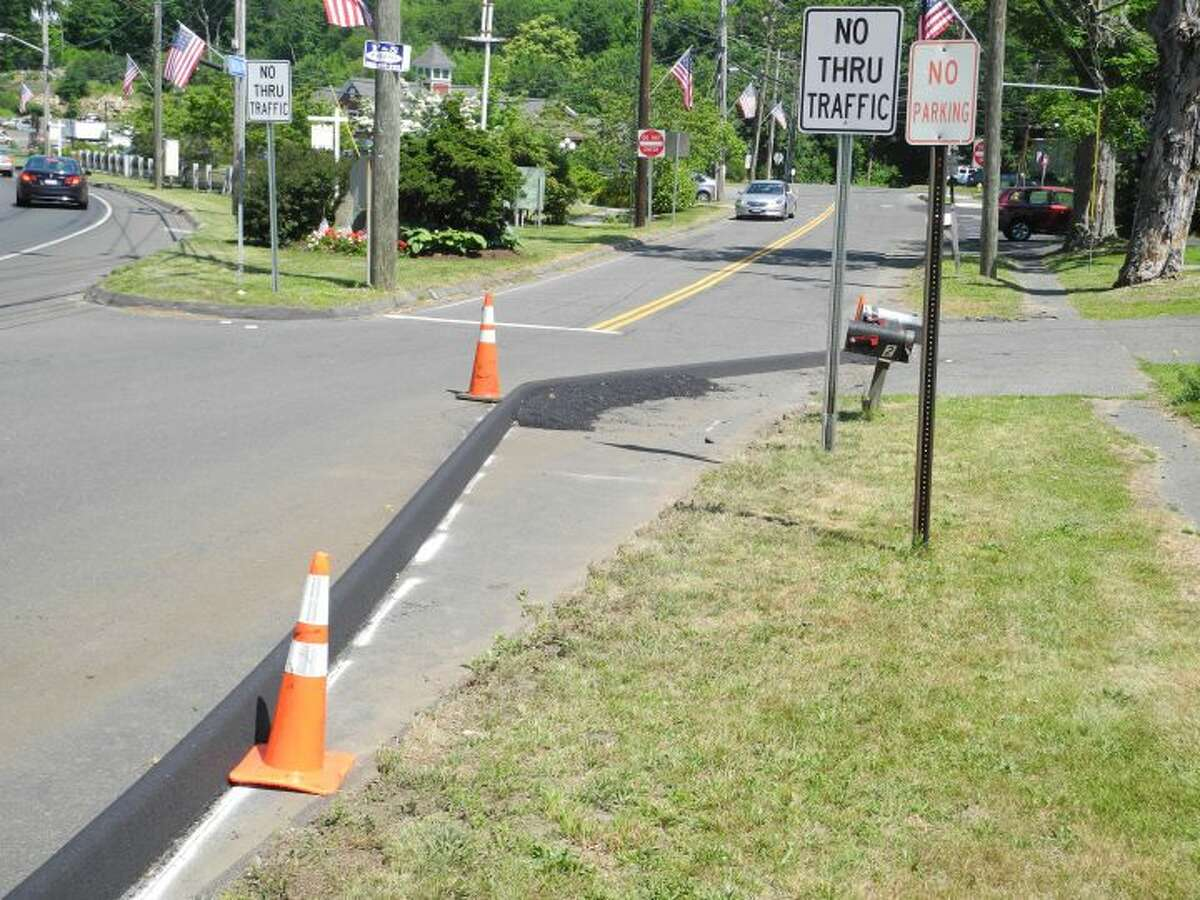While it's a big deal today, the Broadway curb might not be a long-term problem for Trumbull drivers. - Steve Coulter photo