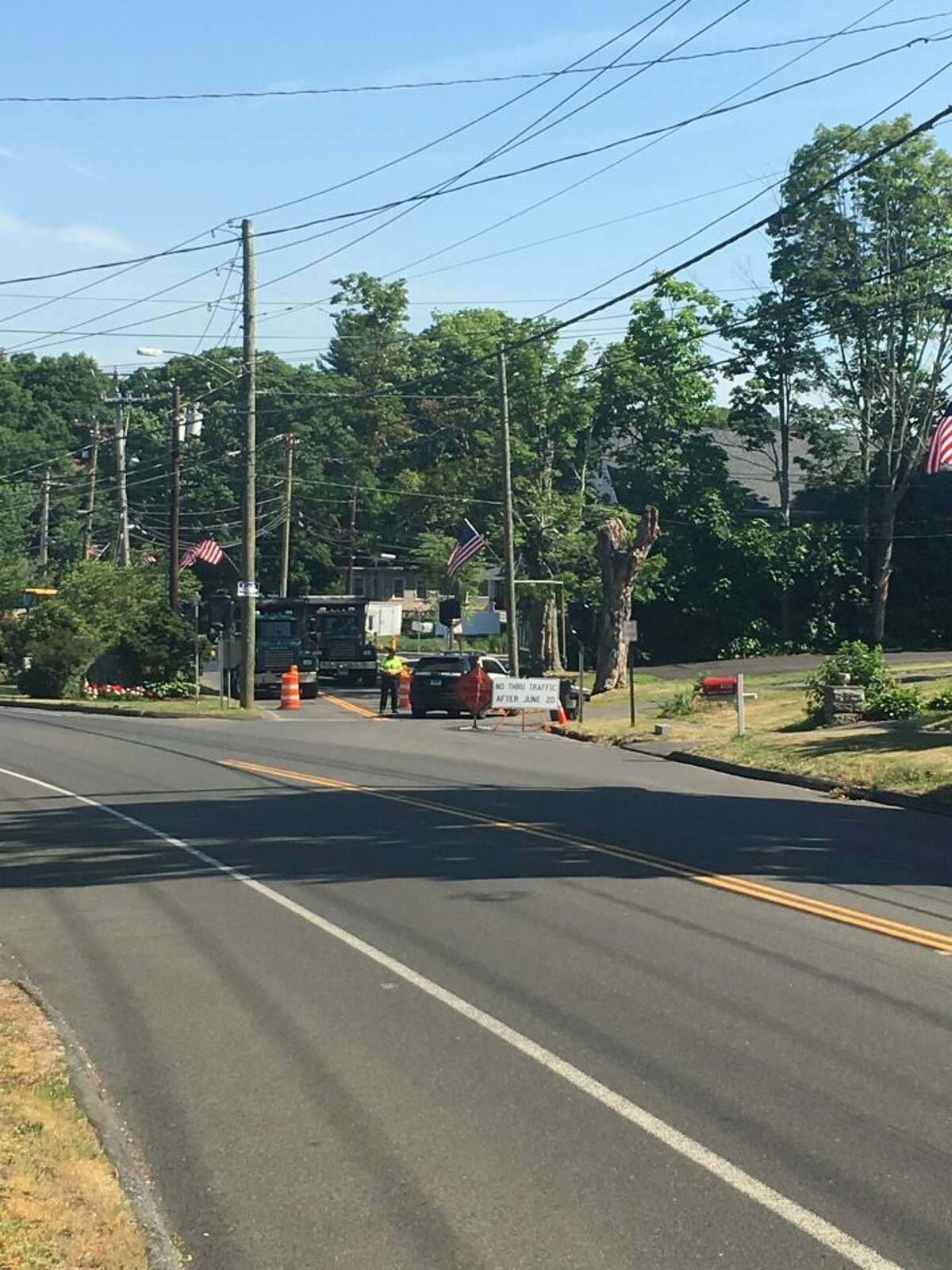 While the curb is currently removed and no traffic changes will be imposed until after the holiday weekend, drivers can expect the intersection to look like it did Monday: trucks and police blocking the northbound entrance. - Steve Coulter