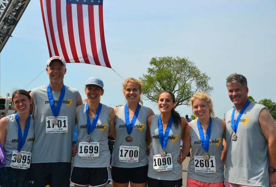 Trumbull residents Oliva Nestro, John Pfohl, Dawn Pfohl, Alexa Pfohl, Rebeca Buck, Sara Steere and Sean Carol put together a team, Miles for Mia, at the Fairfield half marathon Sunday, June 26 that raised awareness for five-year-old Mia McCaffrey. — Lisa Romanchick photo