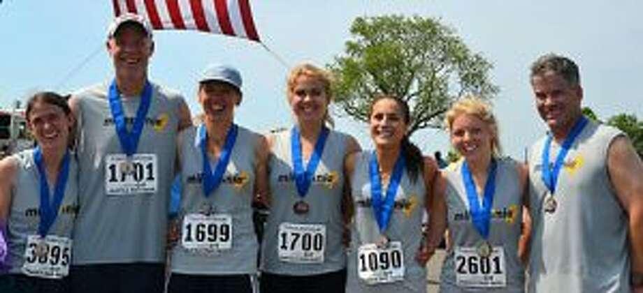 Running Miles for Mia at the Fairfield Half Marathon were Oliva Nestro, John Pfohl, Dawn Pfohl, Alexa Pfohl, Rebeca Buck, Sara Steere and Sean Carroll. — Lisa Romanchick photo