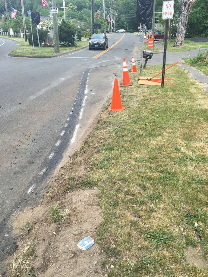 The Broadway Road curb that was installed earlier week was removed Thursday, June 23. — Steve Coulter photo