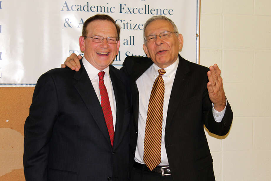 Co-founders of ACE Dan Neumann and Dr. Gary Cialfi, Superintendent of Schools, celebrate the evening at Trumbull High in front of the ACE sign in the Commons at the end of the program. — Sue Berescik photo