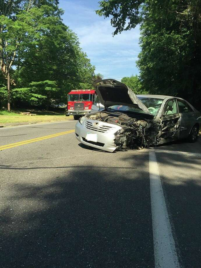 Monroe fire crews helped extricate one driver following a serious two-car collision on Elm Street Monday, June 18.