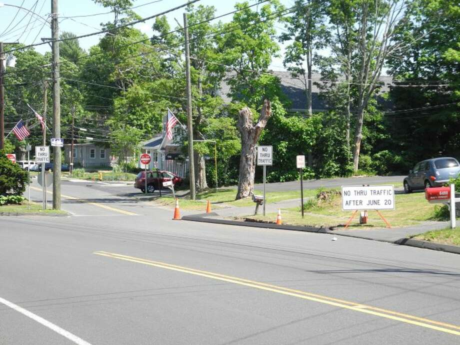 """Trumbull drivers looking to turn off Main Street onto Broadway Road will be denied by a """"No Thru Traffic After June 20"""" sign. — Steve Coulter photo"""