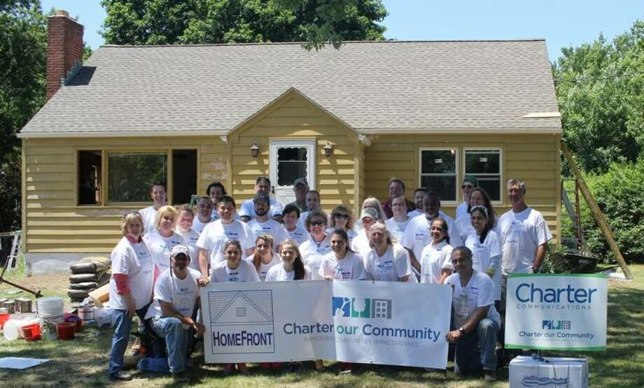 Charter Communications employees and Trumbull residents came together Saturday to make some substantial improvements to the home of Lynda Ryan.