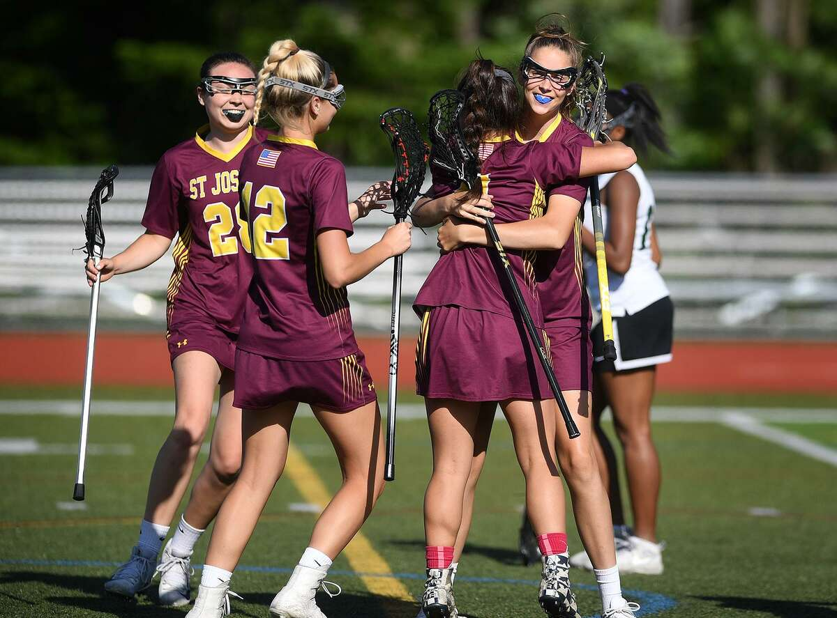 St. Joseph players celebrate a first half goal in their14-10 defeat of top ranked Guilford in the girls lacrosse Class M semifinals at Cheshire High School in Cheshire, Conn. on Monday, June 3, 2019.