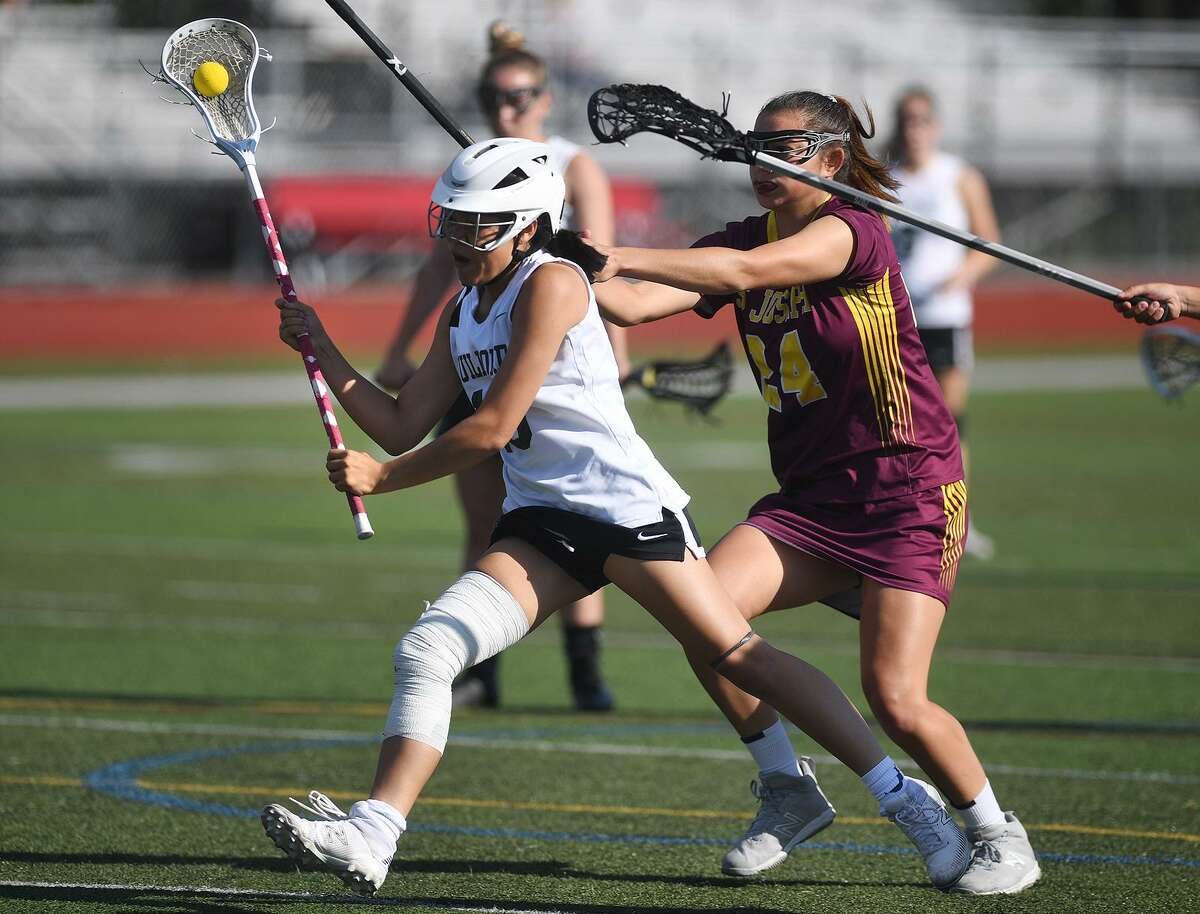 Guilford's Catherine Larrow, left, races to score a goal agaisnt St. Joseph in the Class M semifinals in Cheshire on Monday. The Indians lost 14-10.