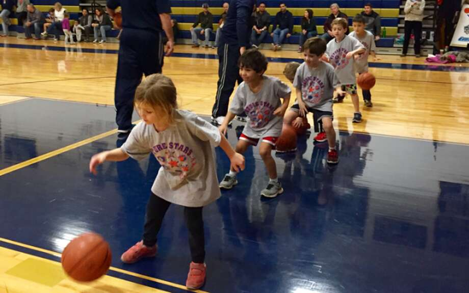Future Stars Sports Academy students show off their basketball dribbling skills.