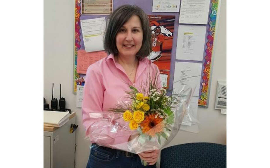 June Canale, a secretary at the Trumbull Early Childhood Education Center receiving her surprise bouquet.