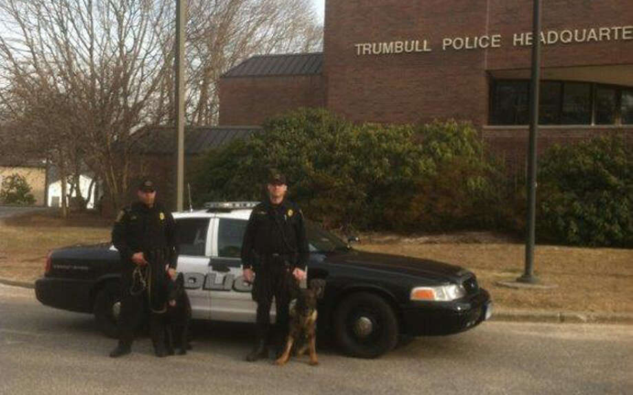 Officer Greg Lee and Storm and Officer R.J. Carlson and Cyrus.