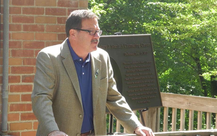 Trumbull resident Bill Sherlach, Mary's husband speaks at the dedication of the center last June.