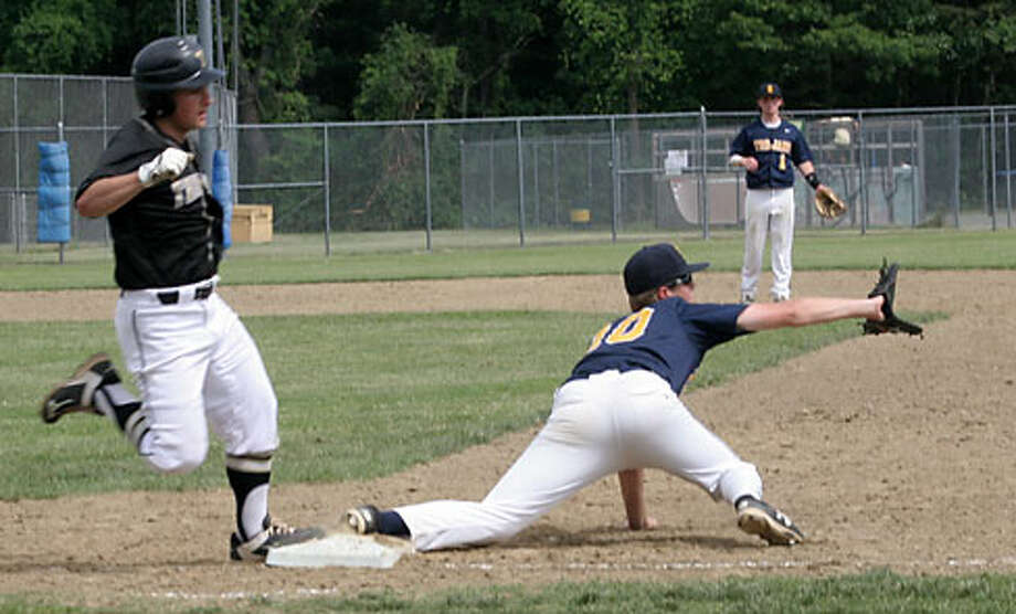 Trumbull High's Alex Rauso beats the throw from right field on his sharp single in the fourth inning. — Bill Bloxsom photo