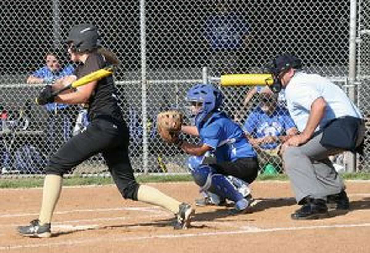Trumbull High's Ally Szabo singles to right field to give her team a 1-0 lead.