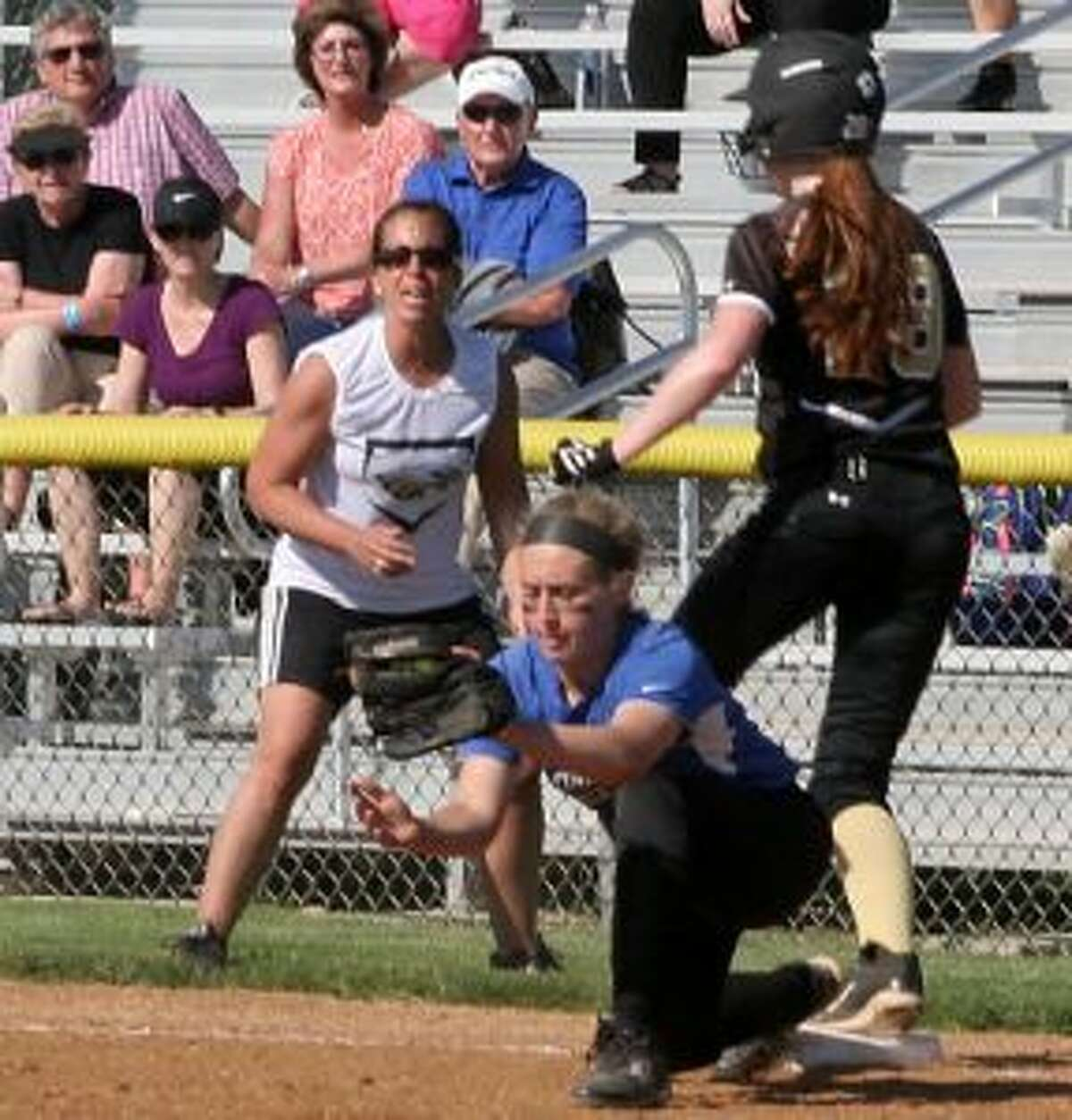 Darien High first baseman Kristen Picard had plenty of work, as Trumbull hit into 12 ground-ball outs.