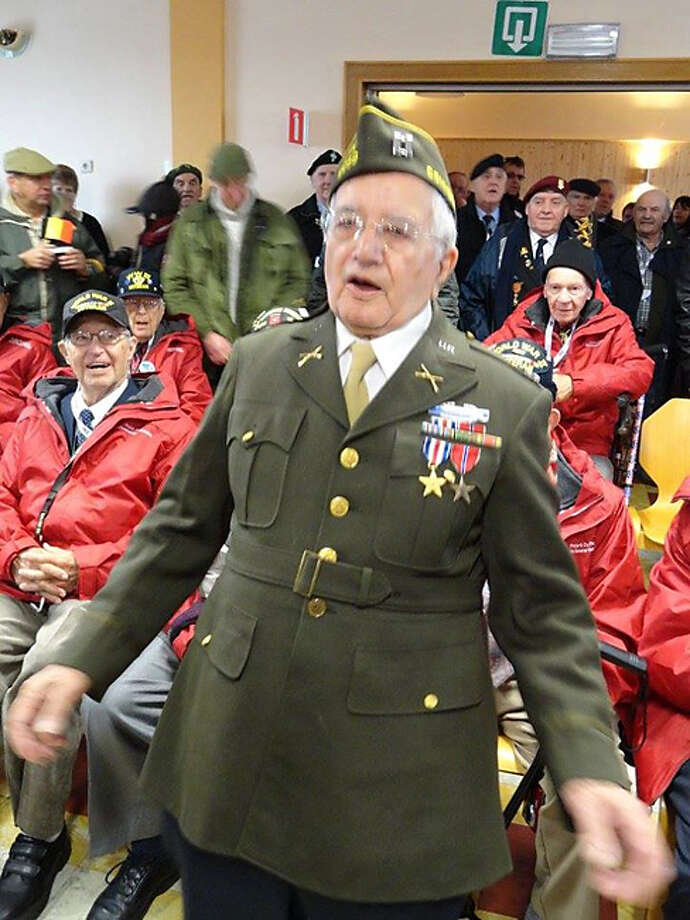 Capt. James Morgia sings a song with fellow veterans during the Battle of the Bulge anniversary events in January 2015.