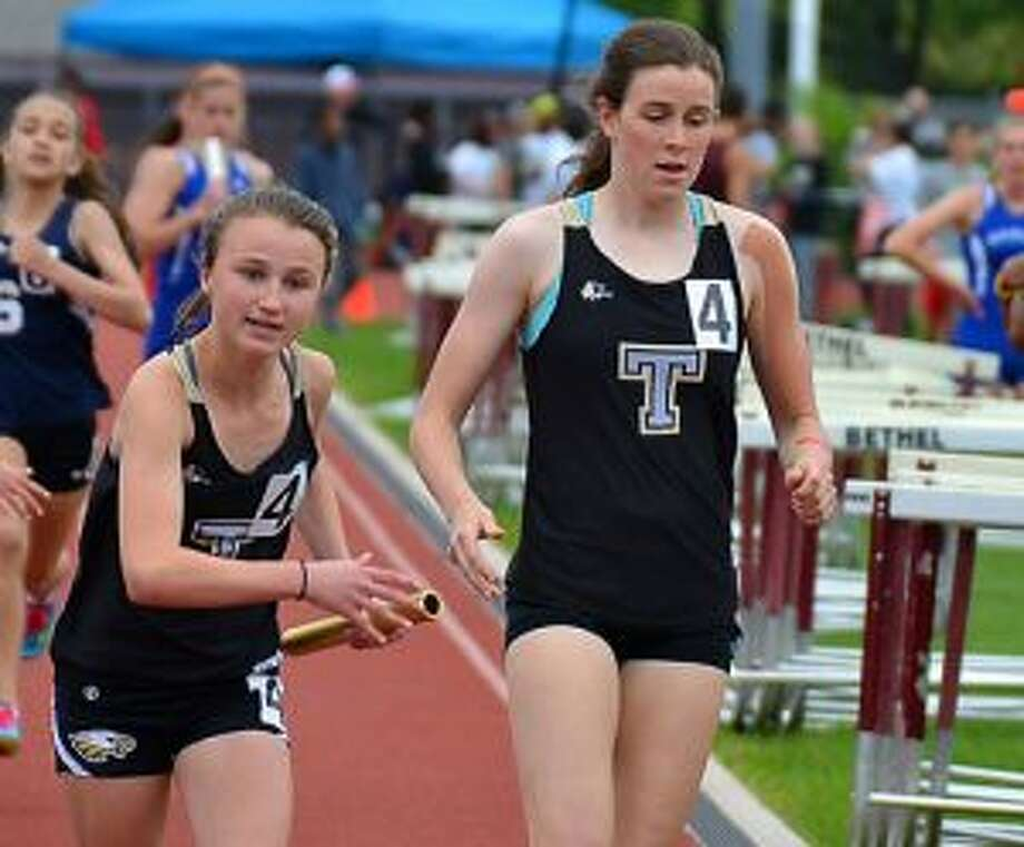 Trumbull High's Margaret LoSchiavo takes baton from Sydney Adams in the 4x800 relay at the FCIACs. The Eagles medaled in the event with a sixth-place finish. — Lisa Romanchick photo