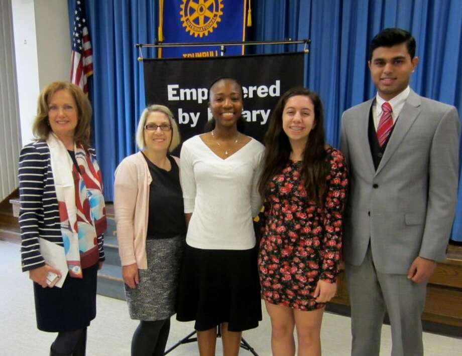 Deborah Cox, left, president of the Trumbull Rotary Club, stands with Trumbull High School debate team coach Hope Spalla and her students Danielle Cross, Julia Esposito and Anush Sureshbabu. Danielle won first place at the Rotary's annual four-way test speech contest with Julia and Anush finishing second and third, respectively.