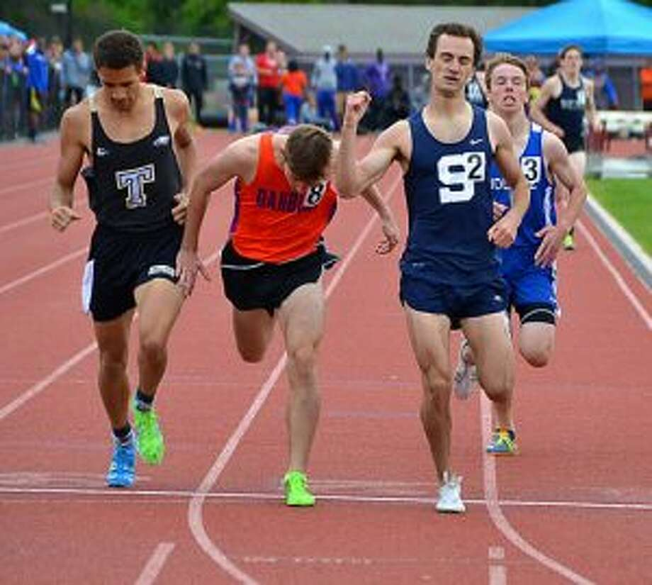 Staples High's James Lewis takes the 800-meter win in 1:56.13 at the FCIAC Championships. Jake Roberts from Danbury was second in 156.20 and Trumbull's Tyler Gleen third in 1:56.22.