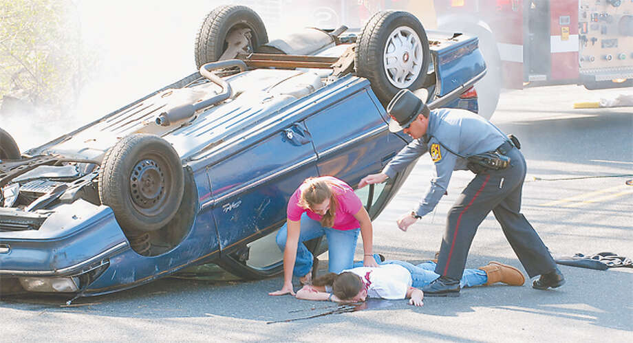 A mock car crash in 2008 held at Ridgefield High School used policemen, firefighters and student actors. —Scott Mullin photo
