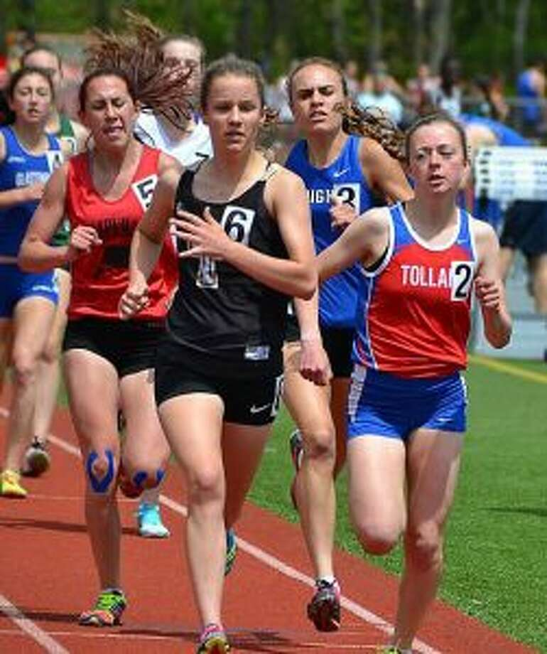 Trumbull High's Kate Romanchick out distances Caitlin Swanson from Tolland and Pomperaug's Ivy Walker to take first in the 1600 with a time of 5:07.69.