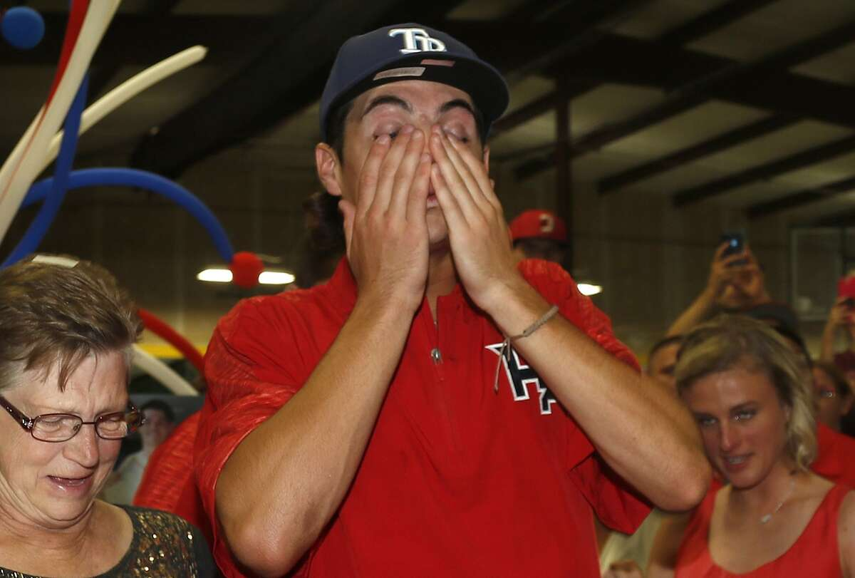 Surrounded by family and friends at the Hunter Pence Baseball Academy, Cypress Ranch pitcher JJ Goss gets emotional after being selected by the Tampa Bay Rays in Monday night's MLB draft.