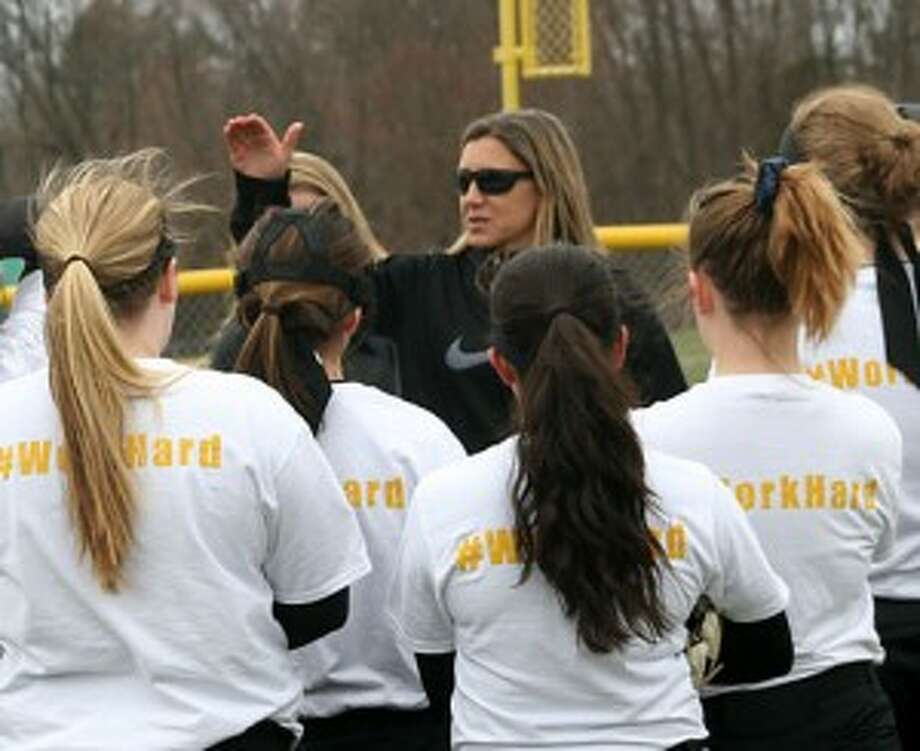 Jacqui Sheftz talks to her Trumbull Eagles prior to a scrimmage. —Bill Bloxsom photo