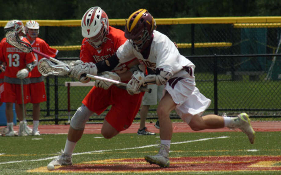 St. Joseph's Matt Labash battles for the faceoff against Ridgefield. — Mike Suppe photo