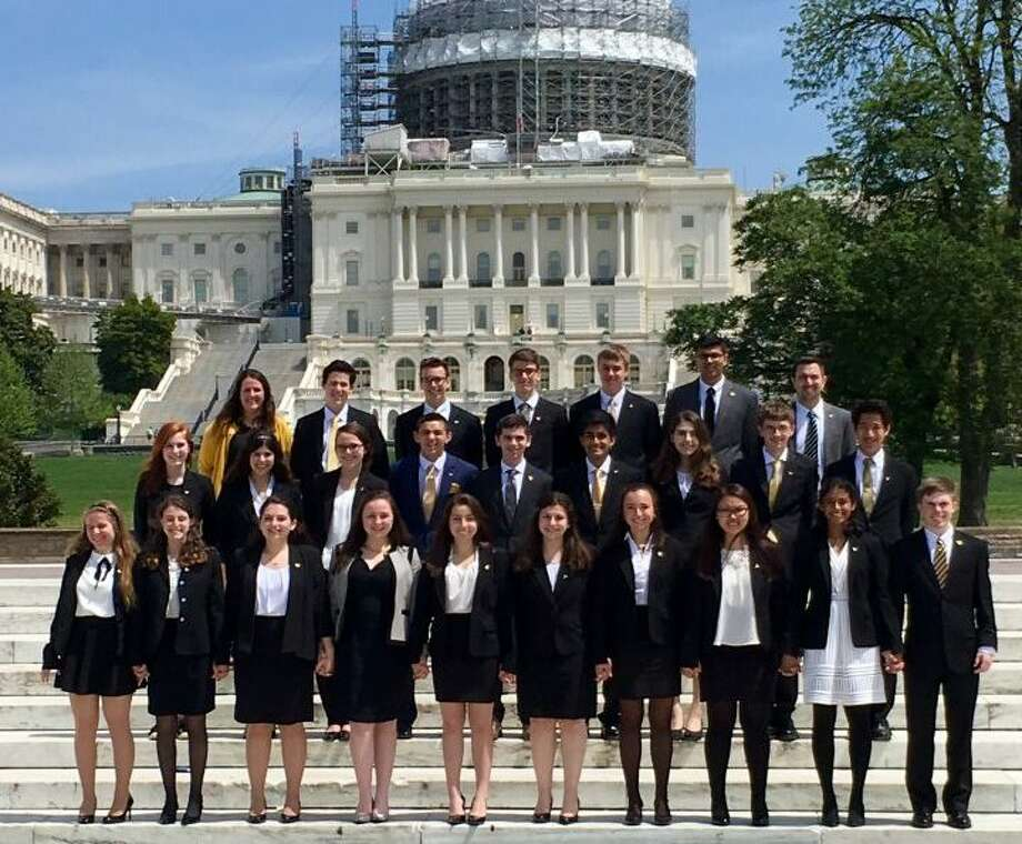 Trumbull High School's We the People team poses outside the Capitol Monday, April 24.