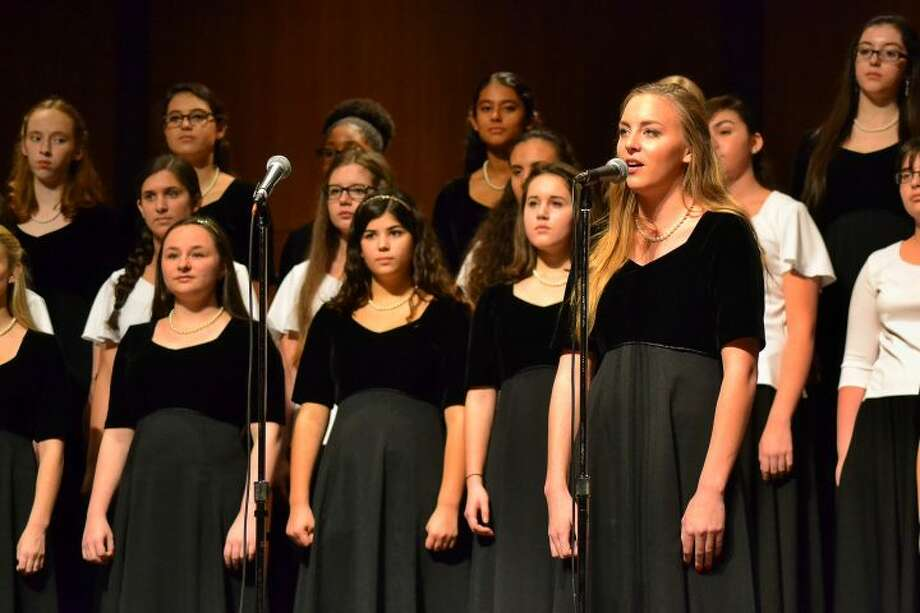 Senior Kelly Cranston leads off the Women's Ensemble group during the winter Holiday Concert 2015. — Lisa Romanchick photo
