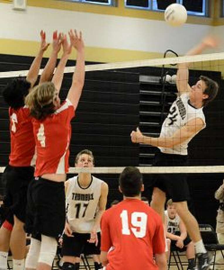 Trumbull's Casey Coughlin delivers a spike during its match with Greenwich. — Andy Hutchison photo