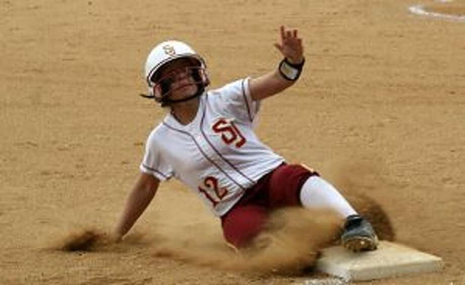 St. Joseph's Hanna Errico slides into third base in the fifth inning in the win over Staples. — Bill Bloxsom photo
