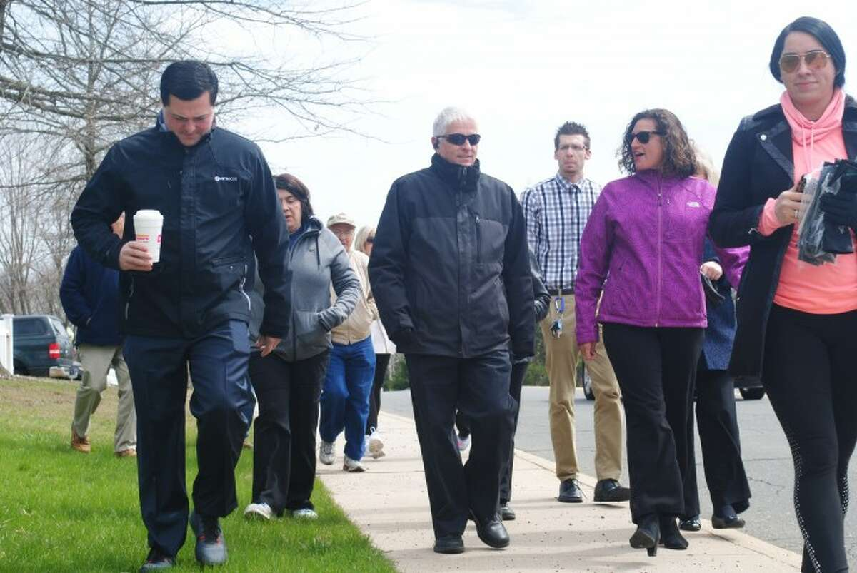 Former First Selectman Timothy Herbst leads walkers on a 30-minute health walk on April 6, 2016. This year's walk in celebration of Move More Month is Wednesday, April 10. - Joe Connolly
