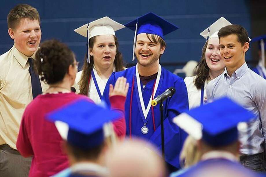 Coleman High School students perform with the choir during the Class of 2019's commencement ceremony on Sunday at the school. For more graduation coverage, go to www.ourmidland.com. (Katy Kildee/kkildee@mdn.net)